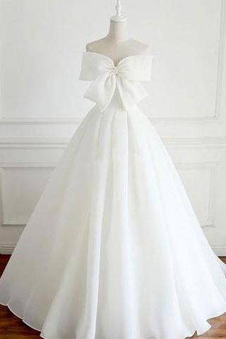 Strapless Bow Accent Organza Ball Gown Wedding Dress Featuring Lace-Up Back